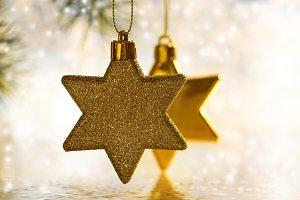 Christmas gold stars on a beautiful