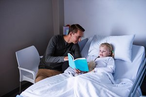 Girl on a hospital bed reading book