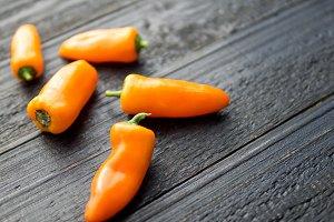 orange ripe small pepper on the tabl
