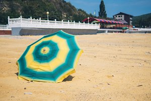 Umbrella from the sun on the sandy y