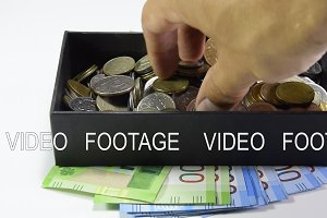 Take coins from a coin box with your