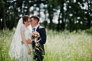 Wedding couple in love at high grass