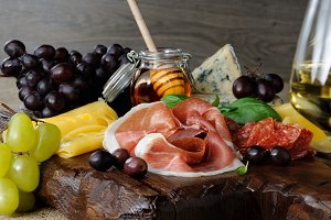 antipasti platter on wooden surface
