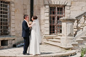 Wedding couple near stairs of old vi