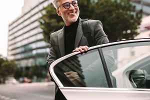 Businessman getting off a cab