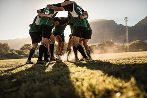 Rugby team showing aggression