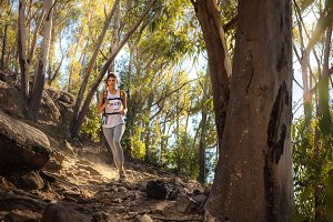 Fit trail runner in mountain trail