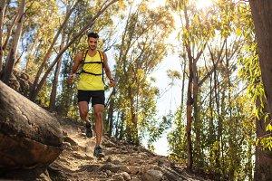 Man running over rocky trail
