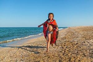 The child is near the sea. Family ho