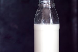 Bottle with milk on a dark backgroun