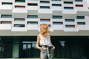Stylish business woman walking