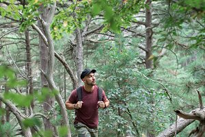 man traveling in the forest