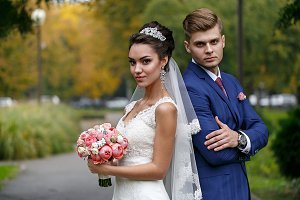 the bride and groom on the street