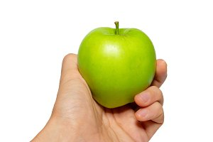 Green tasty apple in a hand isolated