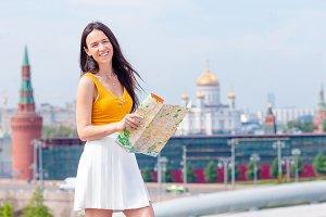 Happy young urban woman in european