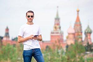 Happy young urban man in european ci