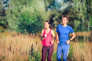 Active sportive couple running in pa