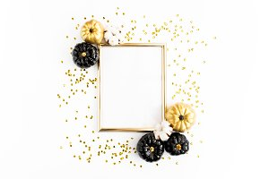 Golden frame decorated with pumpkin