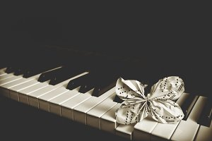 Paper butterfly on piano keyboard