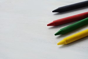 Close up view of colorful wax crayon