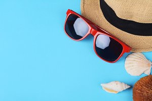 Top view of sunglasses, shells, star