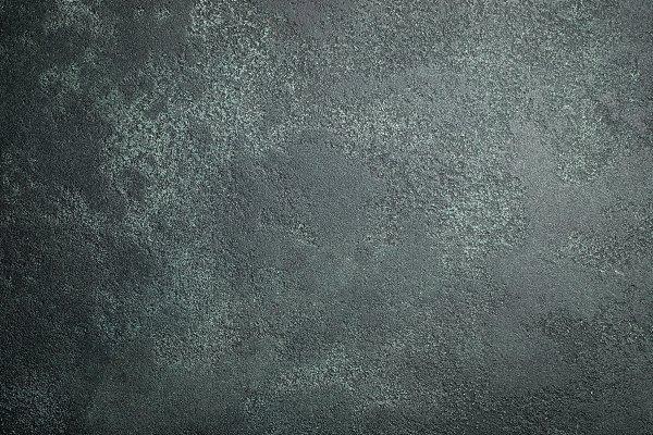 Dark stone or slate wall. Grunge