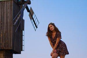 Beautiful girl field and windmill