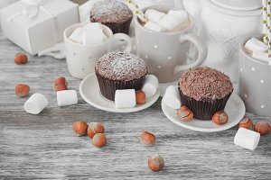 Cacao, chocolate cupcakes, nuts and