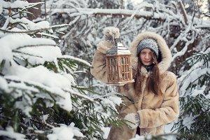 girl holding a lantern