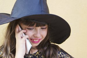 witch talking with the mobile phone