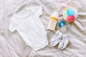 Clothes for baby with baby bottle