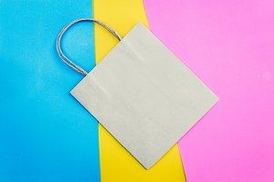 Brown paper bag on colourful