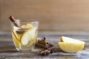 Hot drink with apples for autumn or