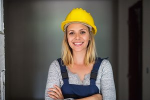 Young woman worker with a yellow