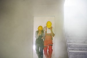 Woman and man workers suffocating at