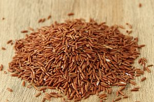 Red rice in a wooden