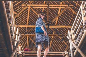 Woman on bamboo stairs. Bamboo eco