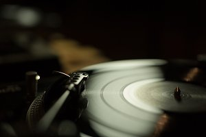 Playing vinyl in dark studio light