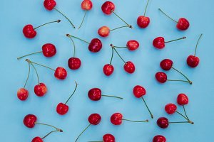 Red cherries on a blue background