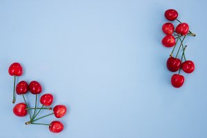Blue background with red cherries