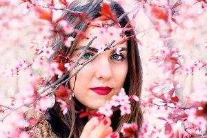 woman among beautiful flowers