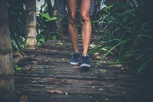 Woman feet on a Rustic wooden bridge