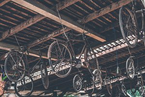 Old vintage bicycles hanging on the