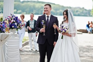 Wedding couple with glasses of champ
