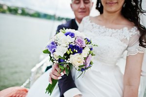 Wedding couple in love at small sail