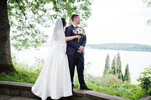 Loving wedding couple hugging backgr