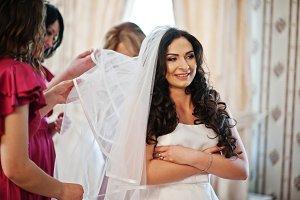 Bridesmaid helped bride wear her wed