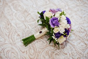 Brides luxury wedding bouquet on tex