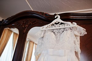 White luxury wedding dress on hanger