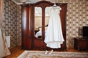 White luxury wedding dress on hanger